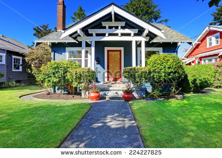 stock-photo-simple-house-exterior-with-tile-roof-front-porch-with-curb-appeal-224227825