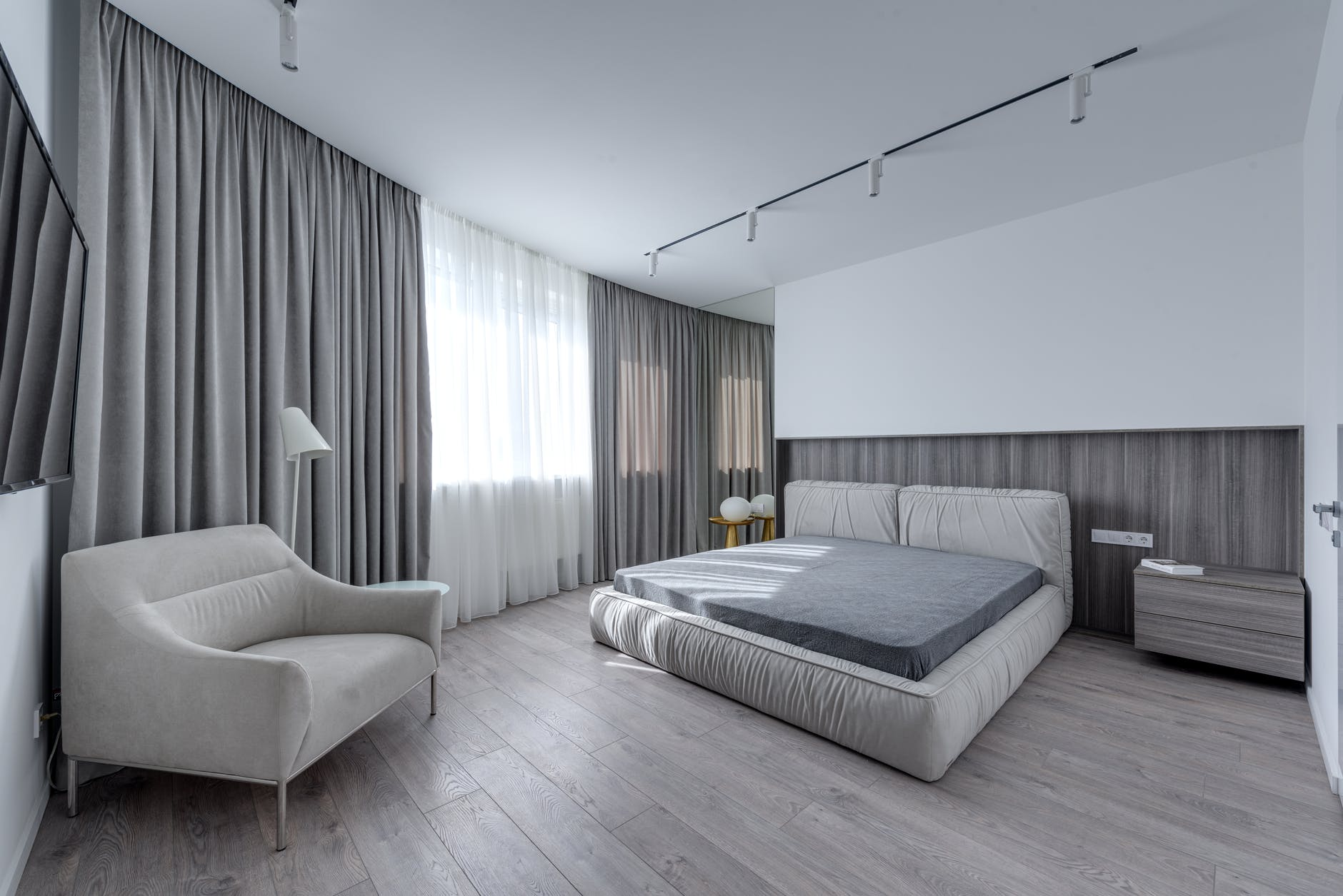 comfortable spacious bedroom in new apartment